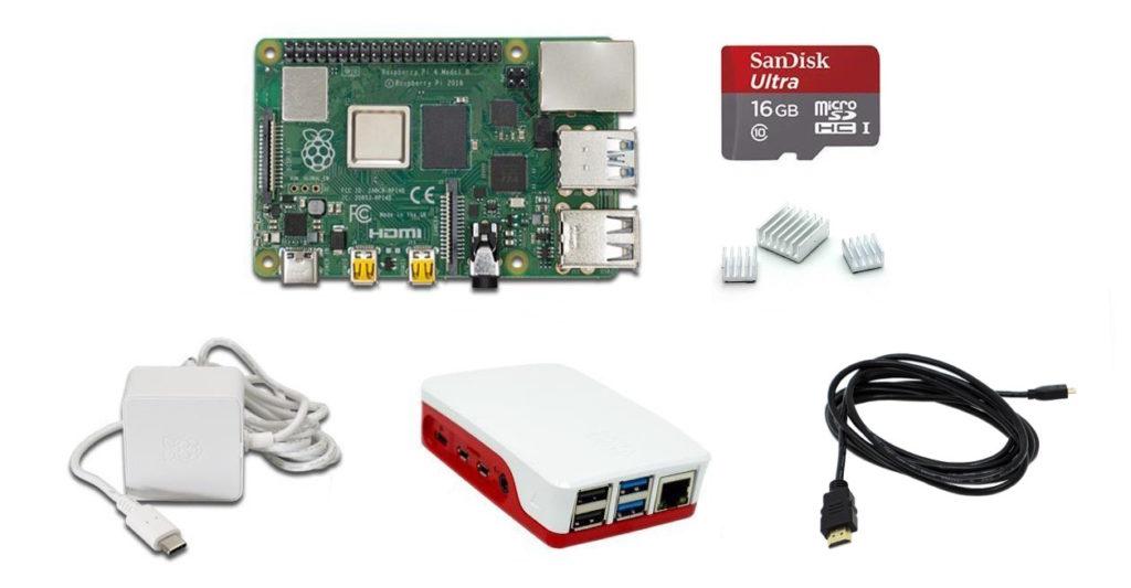 """Das Bild zeigt die einzelnen Komponenten unseres """"Raspberry Pi""""-Sets: Eine """"Raspberry Pi 4 Model B""""-Platine, eine 16 GB fassende microSD-Karte, drei Kühlkörper, ein USB C-Netzteil, ein Gehäuse und ein HDMI-Kabel."""